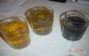 Ideal batches of silver colloid should be in the color-range of the first two glasses on left. Batch on right was made with distilled water heated via microwave. Microwaved foods are similarly affected. An over-done batch will take on a dark gray appearance similar to batch on right which used microwave heated water.
